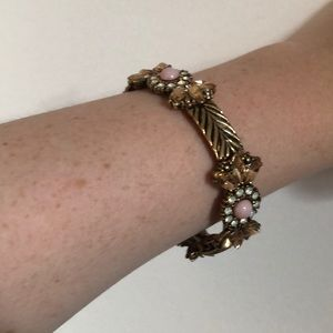 A pink and gold bracelet
